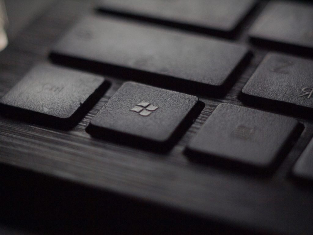 black laptop computer keyboard in closeup photo